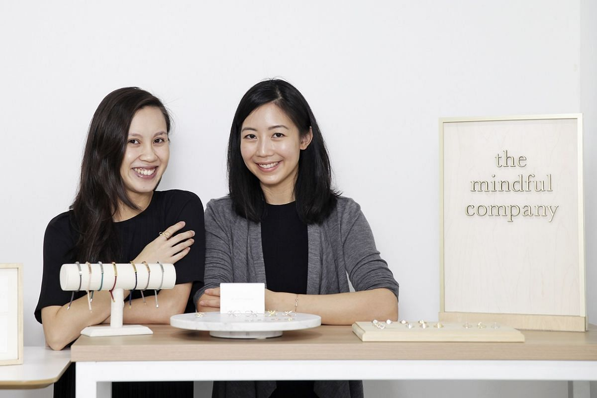 Ms Lim Wen Ling (left) and Ms Ciara Yeo of The Mindful Company make jewellery etched with motivational messages.