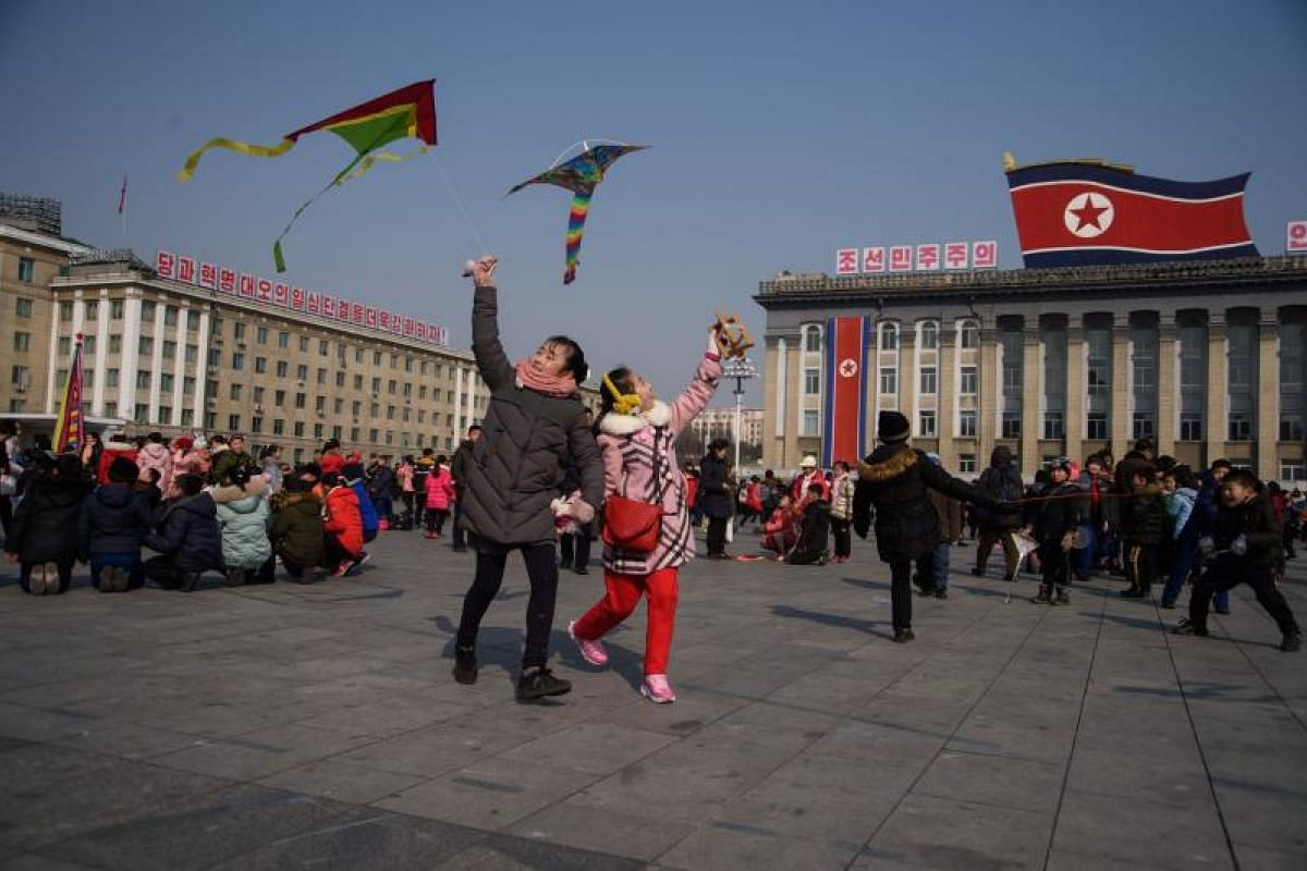 Children fly kites during Lunar New Year festivities on Kim Il Sung square in Pyongyang, North Korea on Feb 16, 2018.