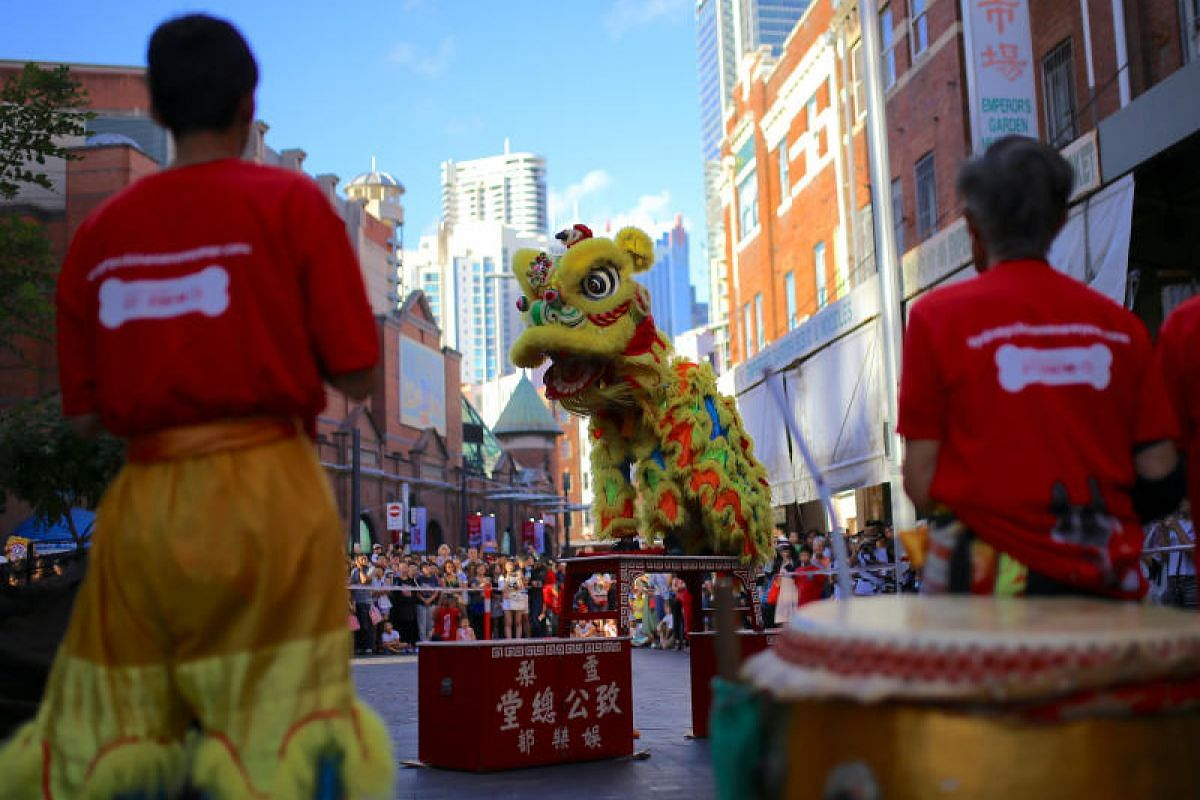 Performers dressed in costumes dance for spectators as part of celebrations for the Chinese Lunar New Year and marking the Year of the Dog in Sydney, Australia, on Feb 16, 2018.
