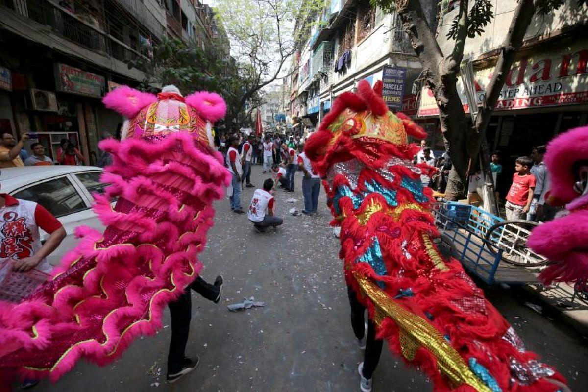 Members of the Chinese community participate in a lion dance during Chinese New Year celebrations in Kolkata, eastern India on Feb 16, 2018.