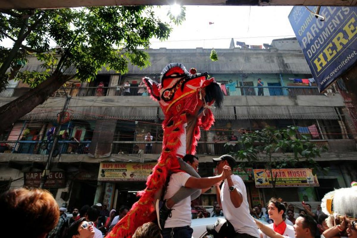 Members of the Chinese community participate in a lion dance during Chinese New Year celebrations in Kolkata, eastern India, on Feb 16, 2018.