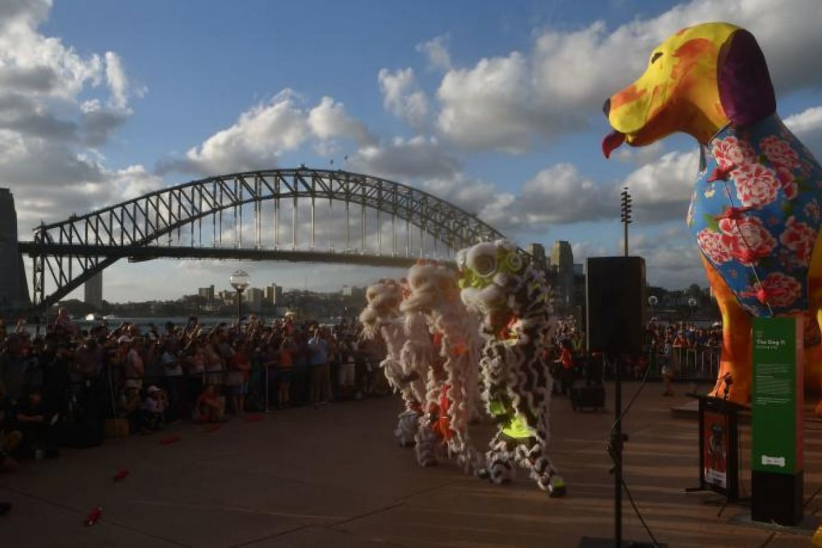 Lion dancers perform in front of the Harbour Bridge and Opera House at the start of the Lunar New Year Festival in Sydney on Feb 16, 2018.