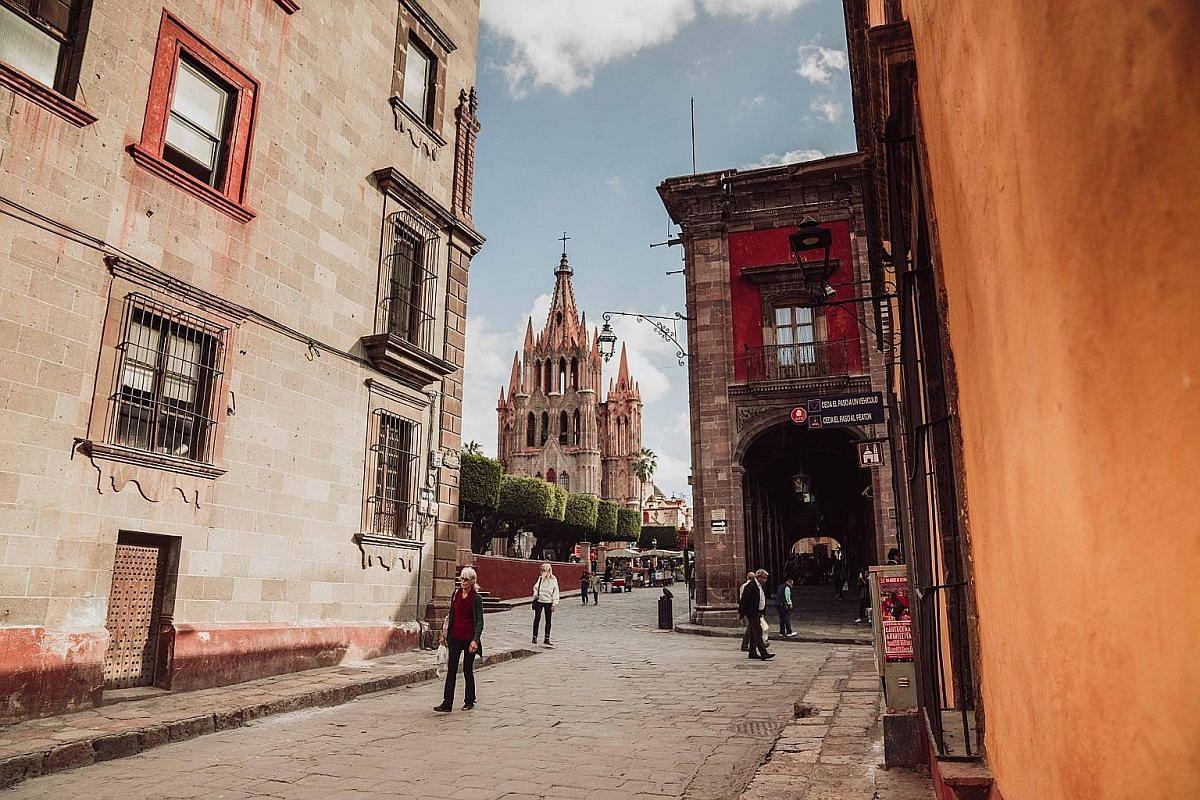 The bohemian city of San Miguel de Allende and its fairy tale-like church, Parroquia de San Miguel Arcangel (centre).