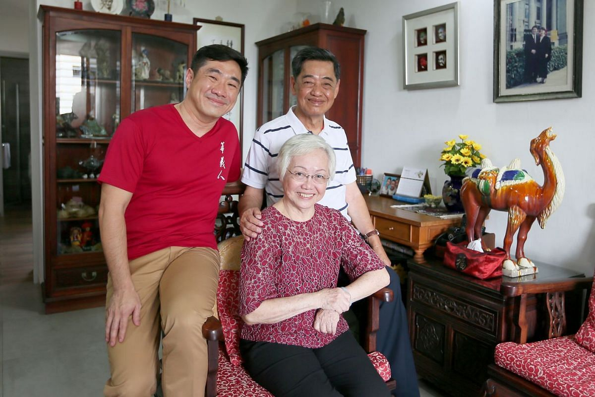 Lawyer Michael Chia, 46, with his parents, Madam Yee Sook Meng, 79, and Mr Chia Kee Chong, 79, at their home in Woodlands.