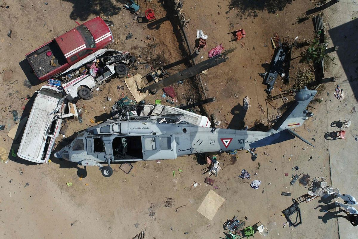 Aerial view of the military helicopter that fell on a van in Santiago Jamiltepec, Oaxaca state, Mexico, on February 17, 2018. PHOTO: AFP