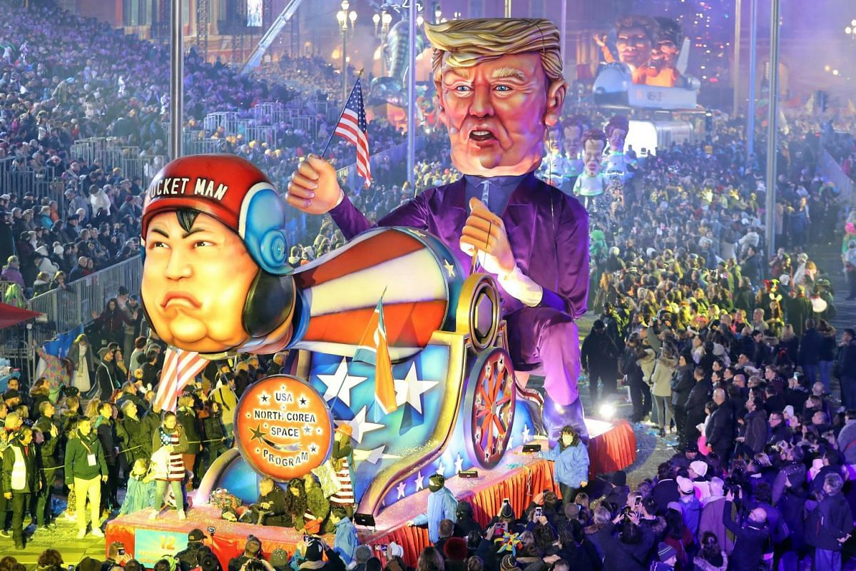 "People look at the float ""US space programme/North Korea"" depicting US president Donald Trump as it parades in the streets of Nice for the 134rd edition of the Nice Carnival on February 17, 2018 in Nice, southeastern France. PHOTO: AFP"