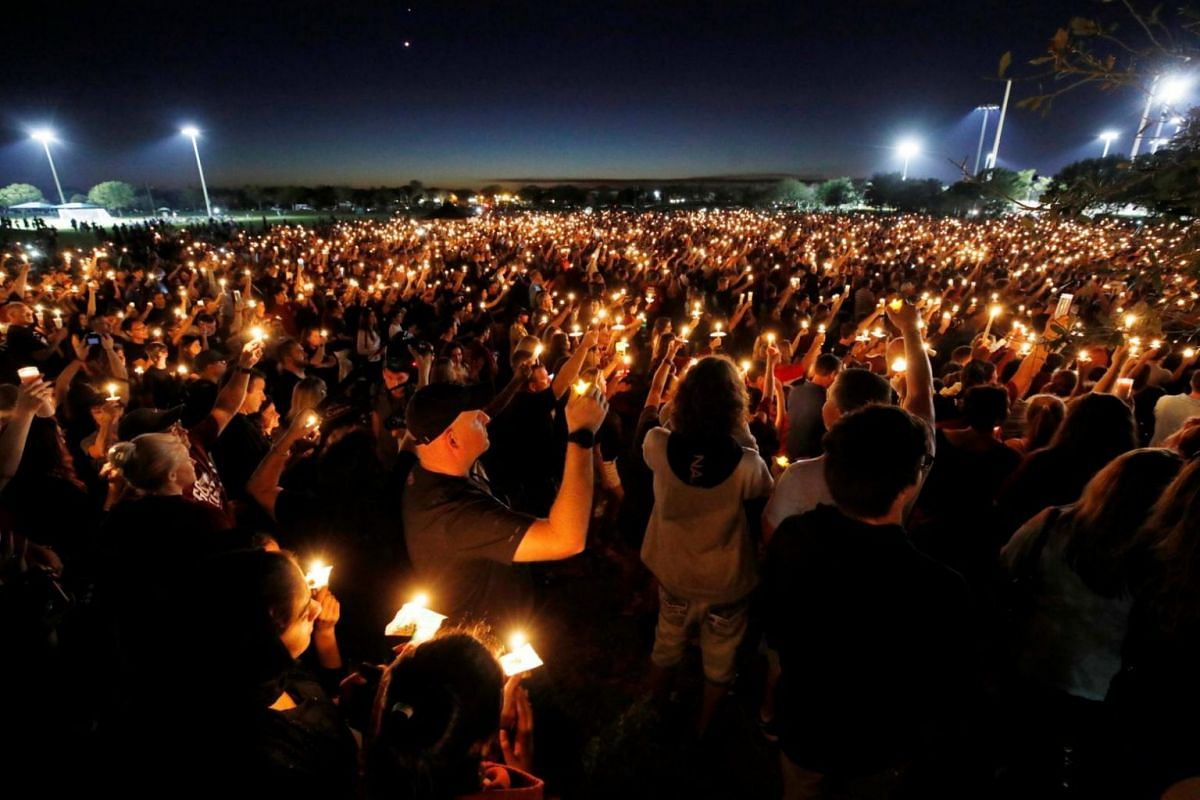 People attending a candlelight vigil a day after the shooting at Marjory Stoneman Douglas High School.