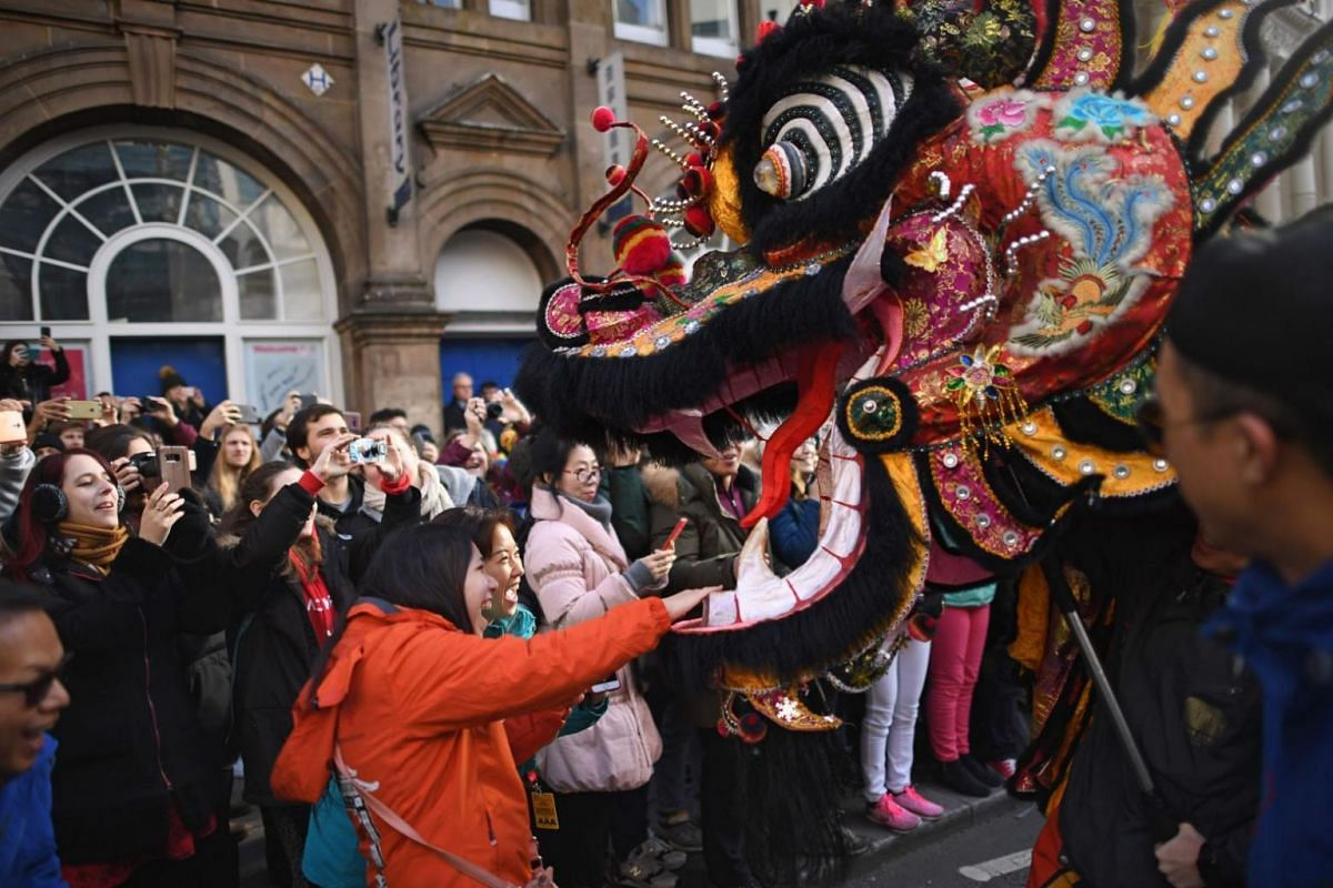 A dragon is paraded though the streets by performers as part of celebrations for the Chinese New Year in central London.
