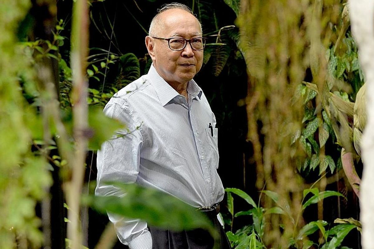 """Mr Tan Jiew Hoe in 2015 with a bronze snail (above) he donated to Gardens by the Bay; and the first successful hybrid of the Corpse Flower, named Amorphophallus """"John Tan"""" (right), blooming at Gardens by the Bay in September 2013."""
