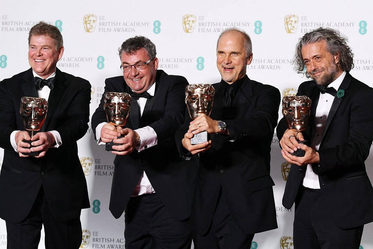 (From left) Special effects artists Richard R. Hoover, Gerd Nefzer, John Nelson and Paul Lambert pose in the press room after winning the award for Special Visual Effects for Blade Runner 2049 during the 71st annual British Academy Film Awards at the