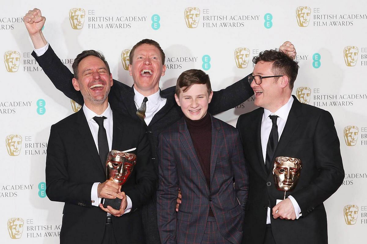Colin O'Toole and Jonas Mortensen hold their awards for British Short Film Cowboy Dave with presenters Sam Spruell and Dylan Naden at the British Academy of Film and Television Awards at the Royal Albert Hall in London, on Feb 18, 2018.