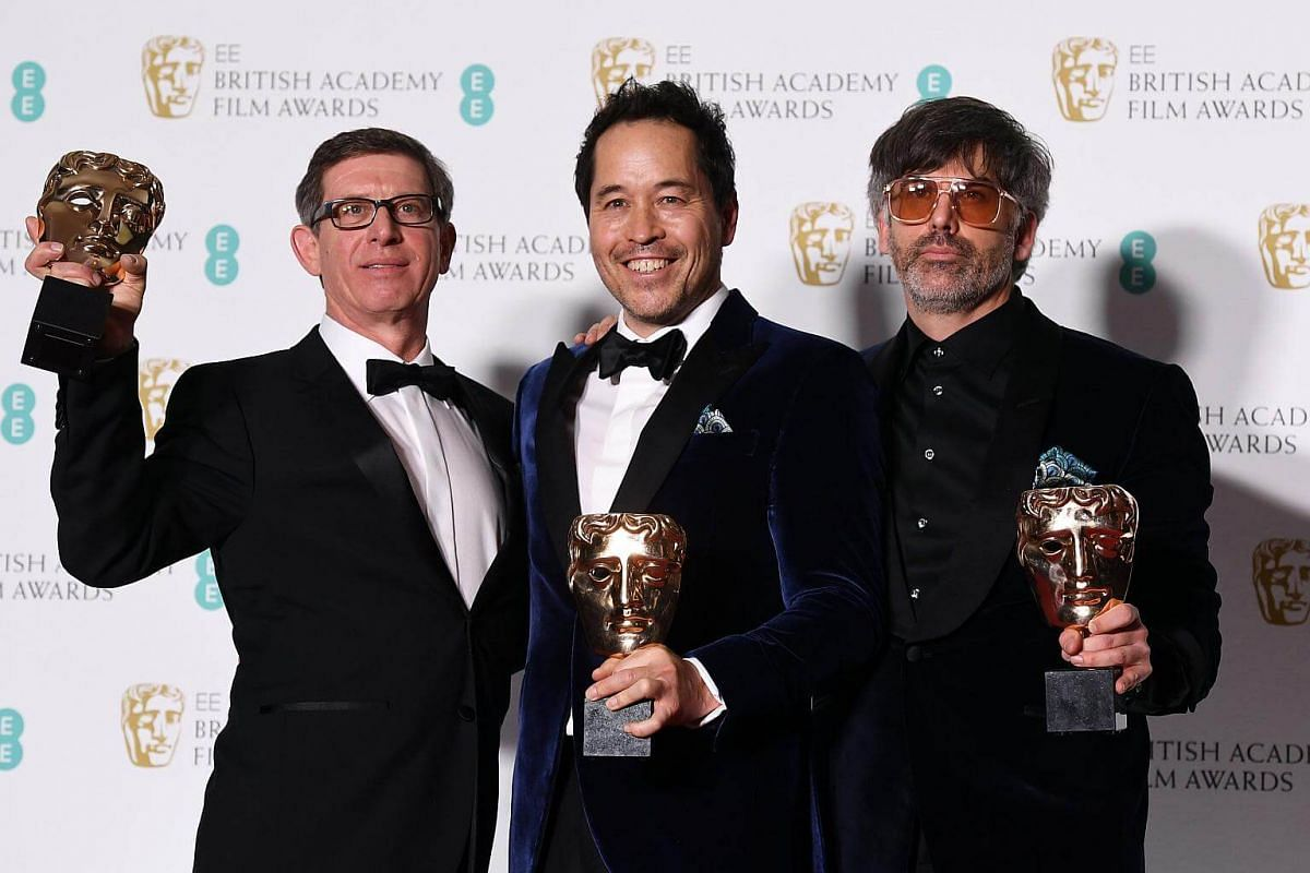 (From left) Jeff Melvin, Paul Austerberry and Shane Vieau pose in the press room after winning the award for Production Design for Shape of Water during the 71st annual British Academy Film Awards at the Royal Albert Hall in London, on Feb 18, 2018.