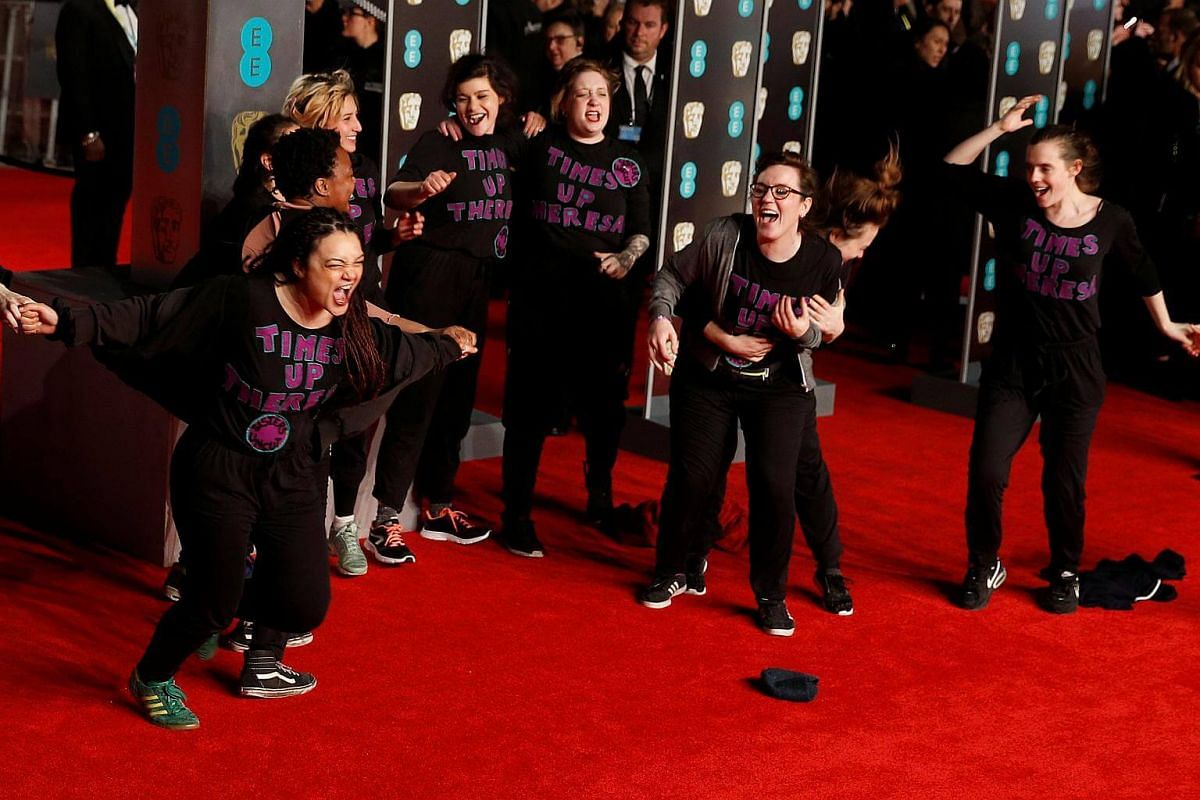 A group of protesters demonstrate on the red carpet at the British Academy of Film and Television Awards at the Royal Albert Hall in London, on Feb 18, 2018.