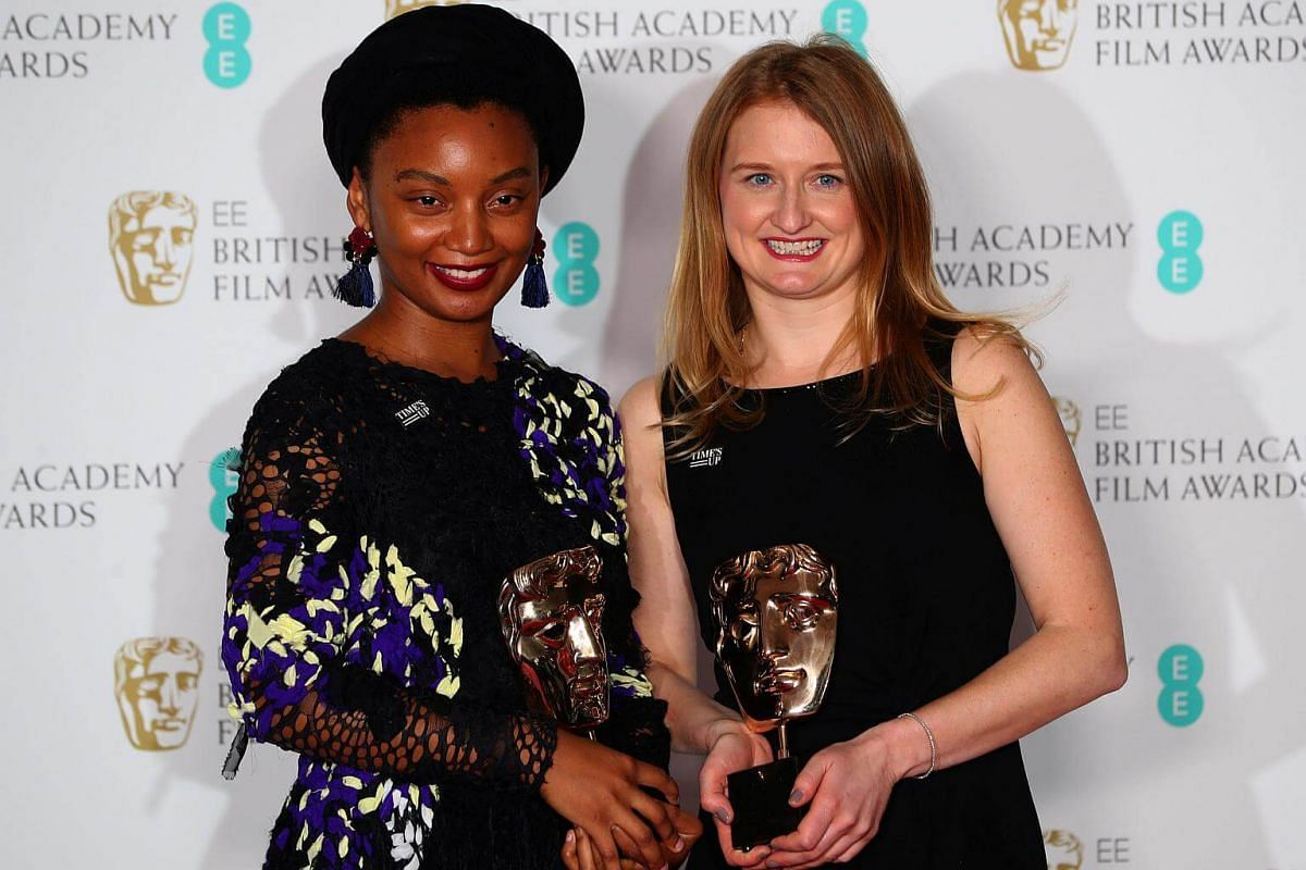 Rungano Nyoni and Emily Morgan hold their awards for an Outstanding Debut by A British Writer, Director or Producer for I Am Not A Witch at the British Academy of Film and Television Awards at the Royal Albert Hall in London, on Feb 18, 2018.