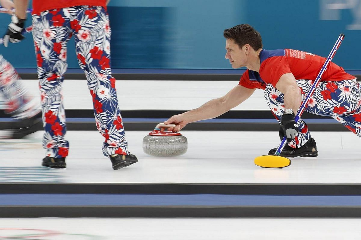 Skip Thomas Ulsrud of Norway delivers the stone.