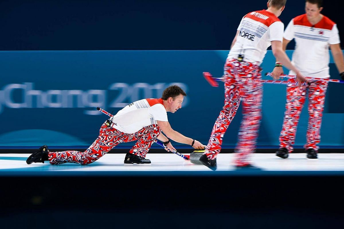 Norway's Torger Nergard throws the stone during the curling men's round robin session between the US and Norway during the Pyeongchang 2018 Winter Olympic Games at the Gangneung Curling Centre in Gangneung, on Feb 18, 2018.