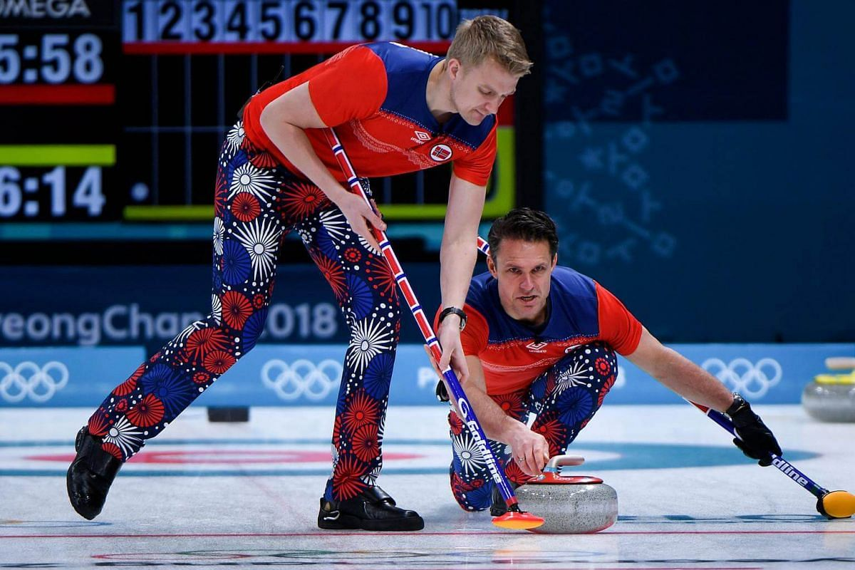 Norway's Thomas Ulsrud pushes the stone during the curling men's round robin session between Norway and Denmark during the Pyeongchang 2018 Winter Olympic Games at the Gangneung Curling Centre in Gangneung, on Feb 18, 2018.