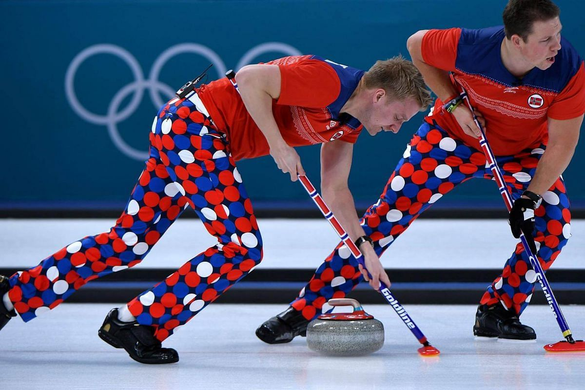 Norway's Christoffer Svae (left) brushes in front of the stone during the curling men's round robin session between Norway and South Korea during the Pyeongchang 2018 Winter Olympic Games at the Gangneung Curling Centre in Gangneung, on Feb 16, 2018.