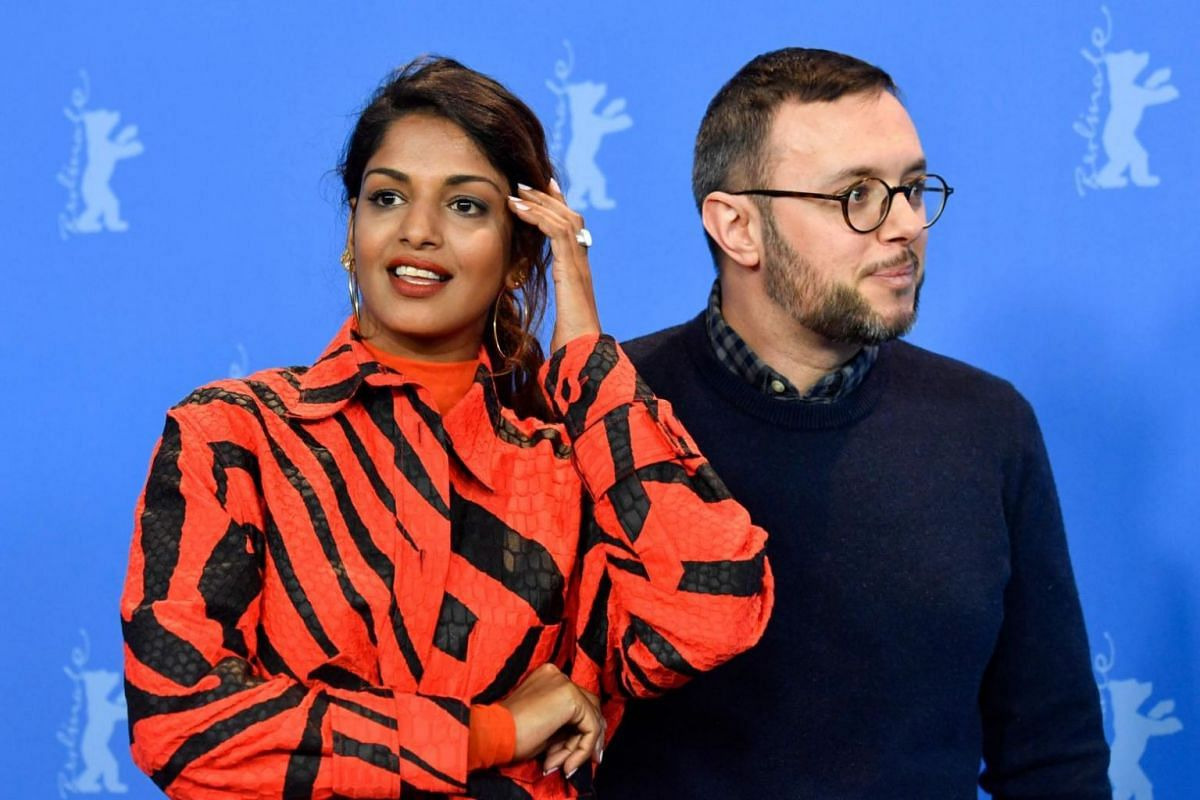 Singer-songwriter M.I.A. and director Steve Loveridge pose during a photocall before a press conference to present the film MATANGI / MAYA / M.I.A. in the Berlinale special gala category.