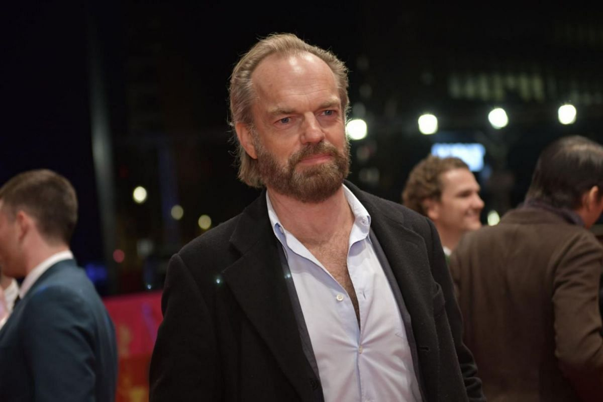 English-Australian actor Hugo Weaving poses on the red carpet upon arrival for the premiere of the film Black 47.