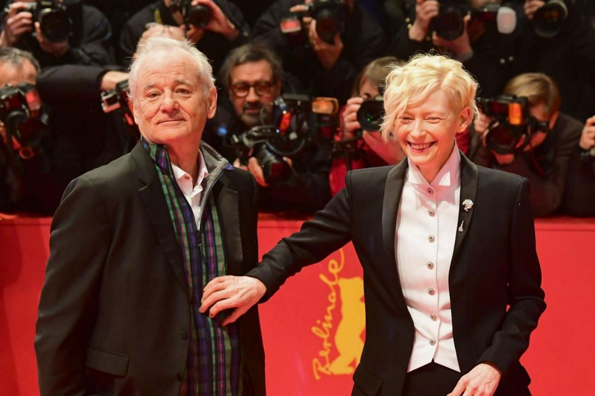 US actor Bill Murray and British actress Tilda Swinton pose on the red carpet at the opening ceremony of the 68th annual Berlin International Film Festival.