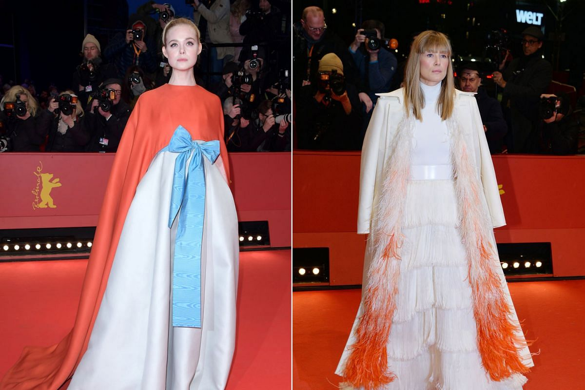 Actress Elle Fanning and Rosamund Pike posing at the red carpet for the opening ceremony of the 68th annual Berlin International Film Festival.