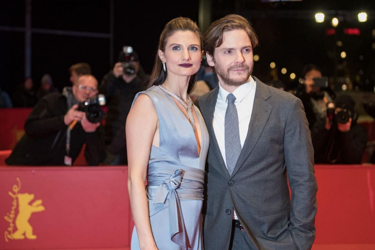 German actor Daniel Bruehl and his partner Felicitas Rombold pose on the red carpet for the premiere of the film 7 Days In Entebbe.