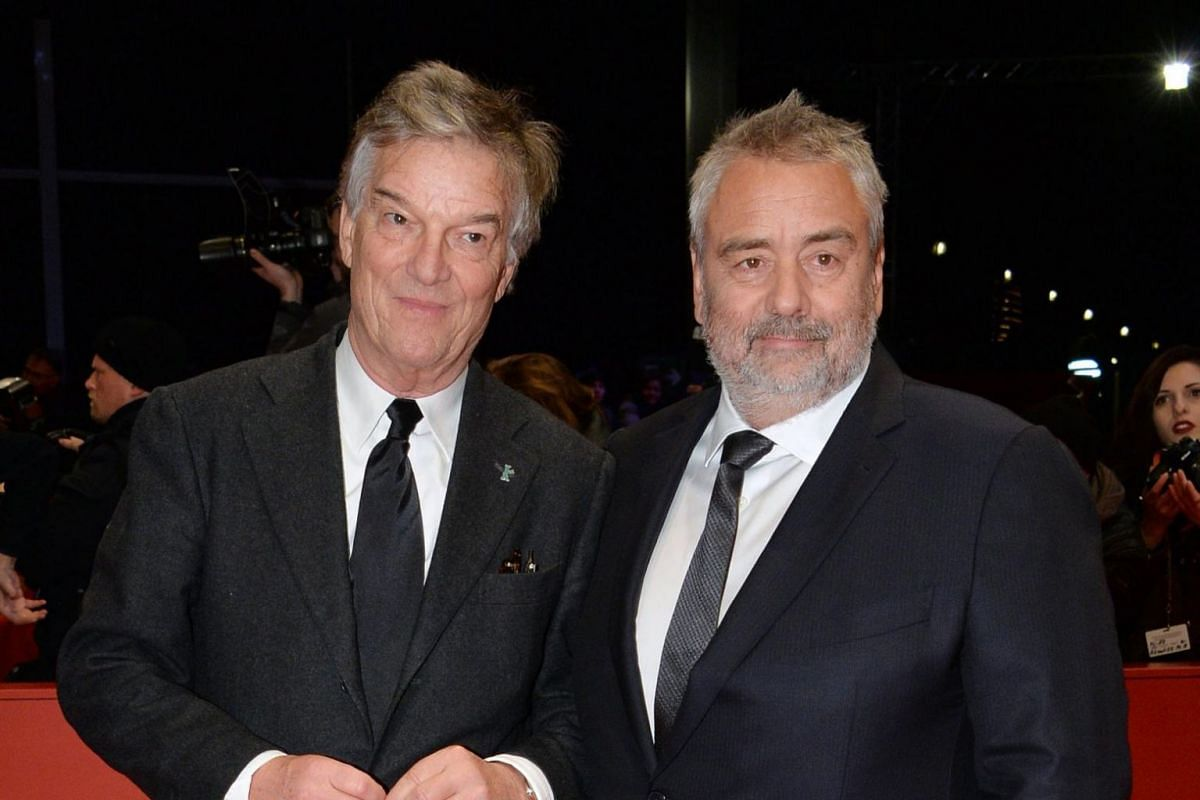 Directors Luc Besson (right) and Benoit Jacquot arrive for the premiere of Eva.