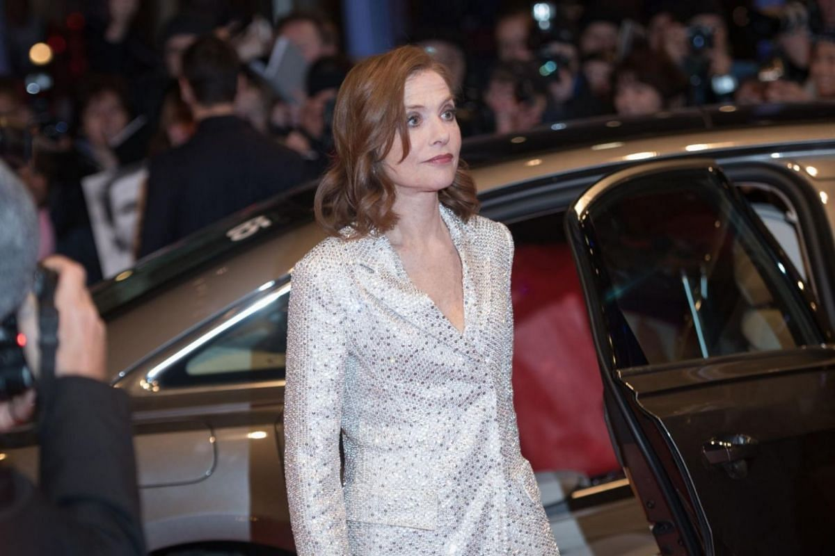 French actress Isabelle Huppert poses on the red carpet upon arrival for the premiere of Eva.
