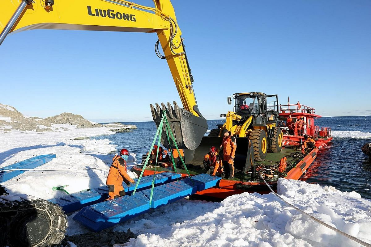 Chinese workers moving an excavating loader on Inexpressible Island in Antarctica last month, where Beijing's new research station will be built. The base will provide year-round support for researchers carrying out observations of the land, ocean, a