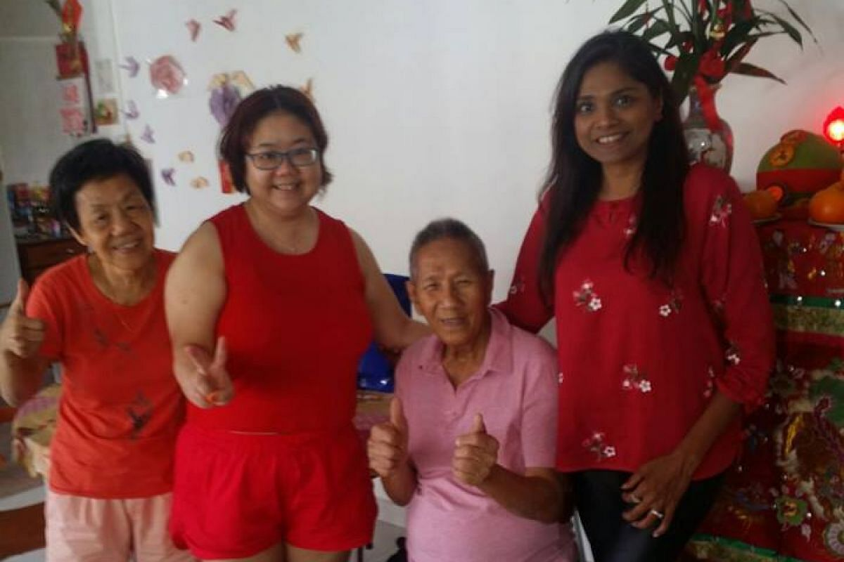 ST reader Karyn Ashley Shyan with her parents and her father's friend posing for a photo at her home in Sembawang on the first day of Chinese New Year.