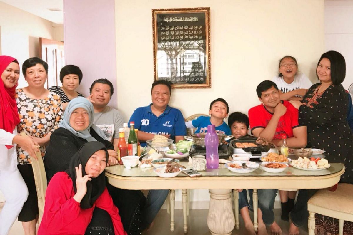 ST reader Muhammad Ramzy Bin Sulaiman (fourth from left, seated) and wife Zhou Shengrui (standing on his right), who is from Heilongjiang, China, celebrating Chinese New Year with their family members.