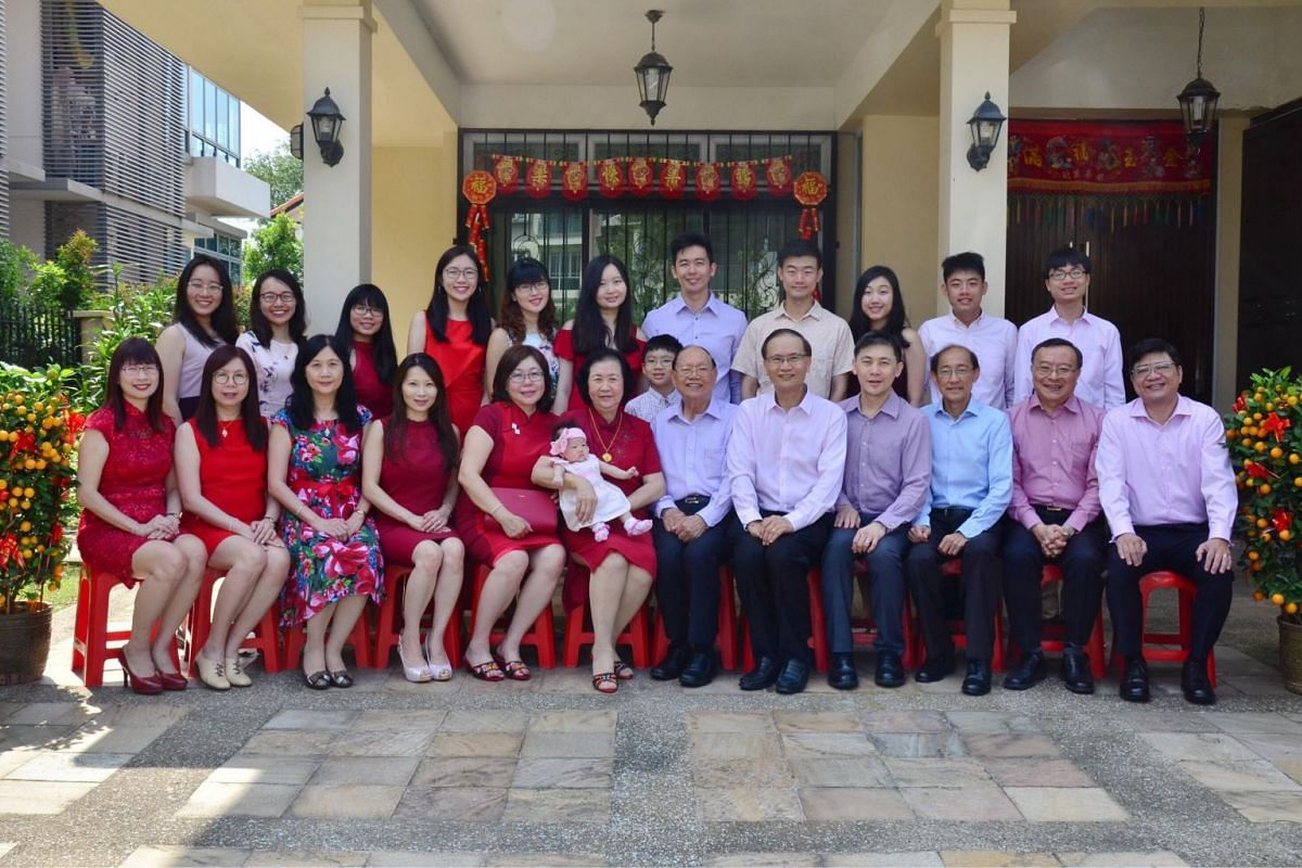 ST reader Tan Tian Min with (standing, fourth from left) and her family celebrating their first Chinese New Year as four generations, with the first grand-daughter being born in November 2017. Her grandparents will also be celebrating their 60th wedd
