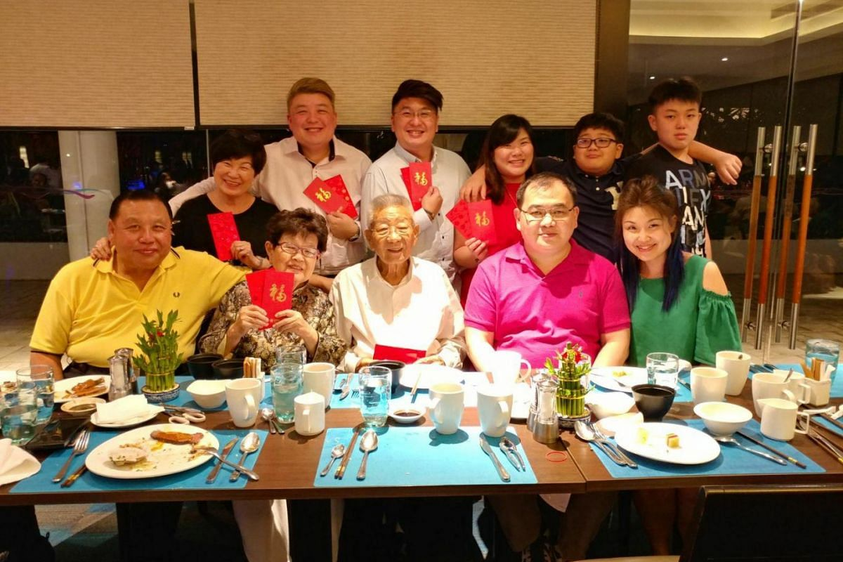 ST reader Kaiyi Chng (standing, third from right) with her family on the eve of Chinese New Year during their reunion dinner at Aquamarine, Marina Mandarin.
