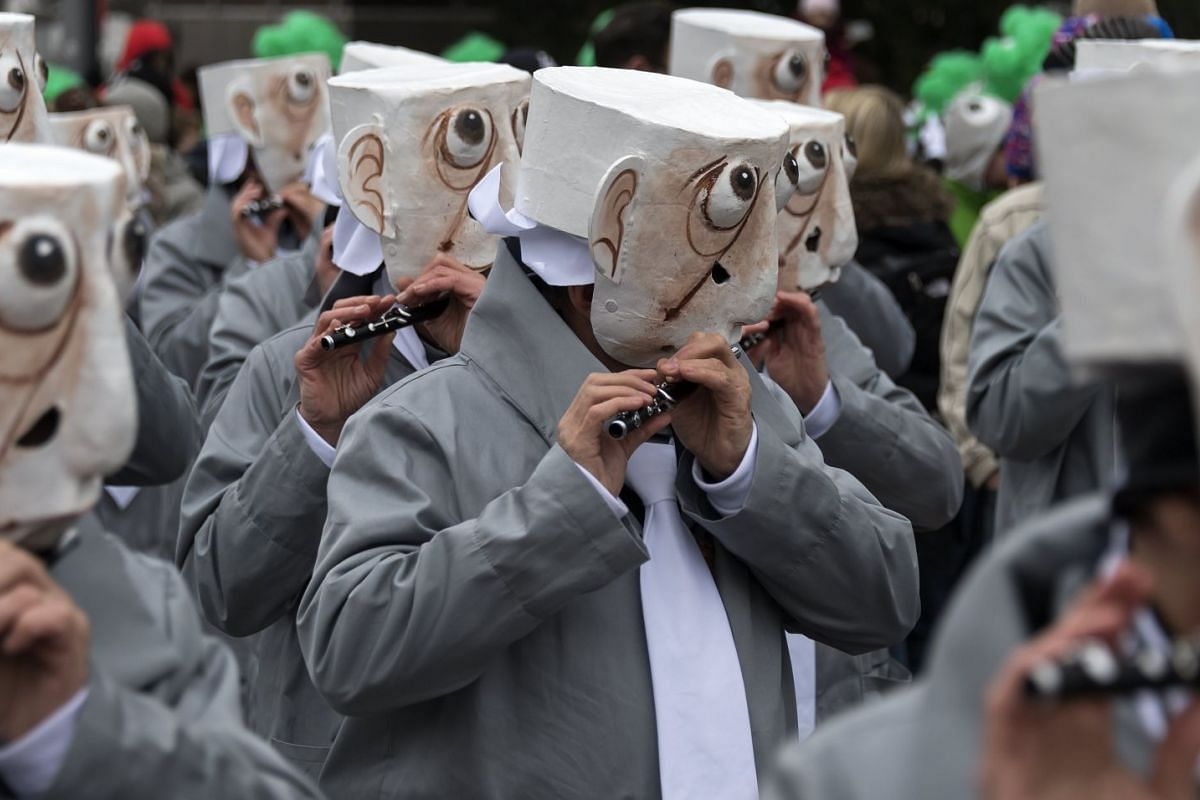 Revellers participate in a carnival procession in Basel, Switzerland, on Feb 19, 2018.