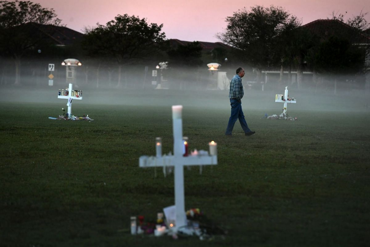 Steve Zipper visits a makeshift memorial in Pine Trails Park for the victims of the Parkland, Florida, school shooting.