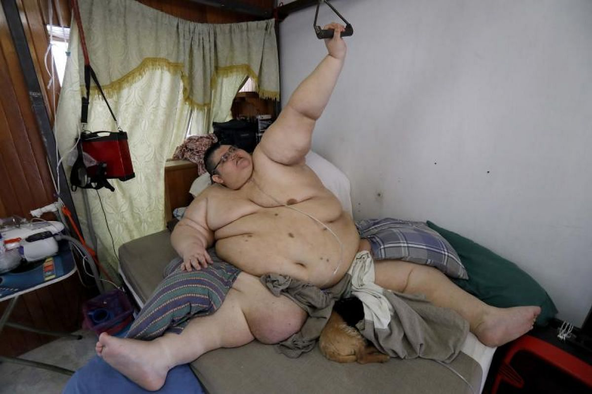 Mexican Juan Pedro Franco, the heaviest man in the world according to the Guinness World Records in 2017 with a weight of 595 kilograms, exercises at his house in Guadalajara, Jalisco state, Mexico. Franco, 33, lost 250 kilograms after undergoing a m