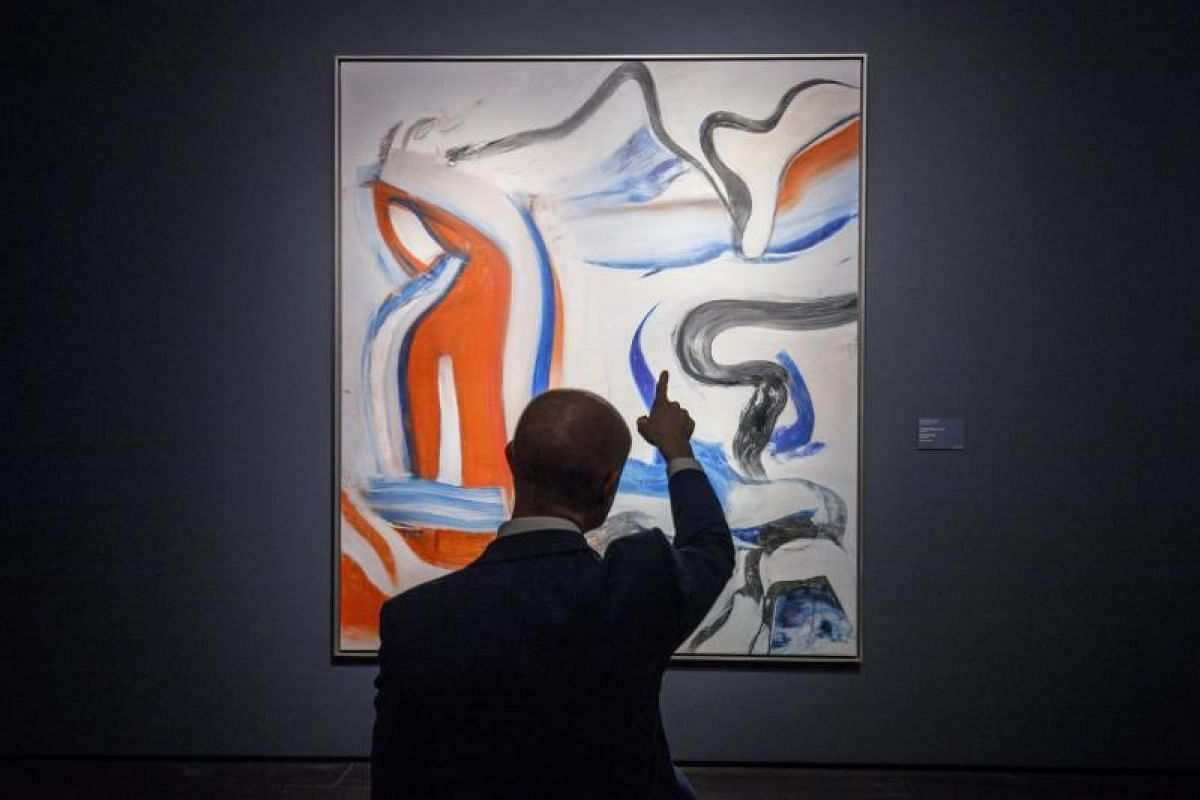 A visitor looks at the painting 'Untitled XIX' by Dutch artist Willem de Kooning during a photocall for the Impressionist and Modern Art Evening Sale at Christie's auction house in London, Britain on Feb 20, 2018. The sale will take place on Feb 27.