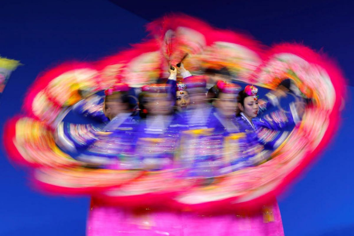 Dancers perform a traditonal dance before the medals ceremony at the Olympic park in Pyeongchang, South Korea on Feb 20, 2018.