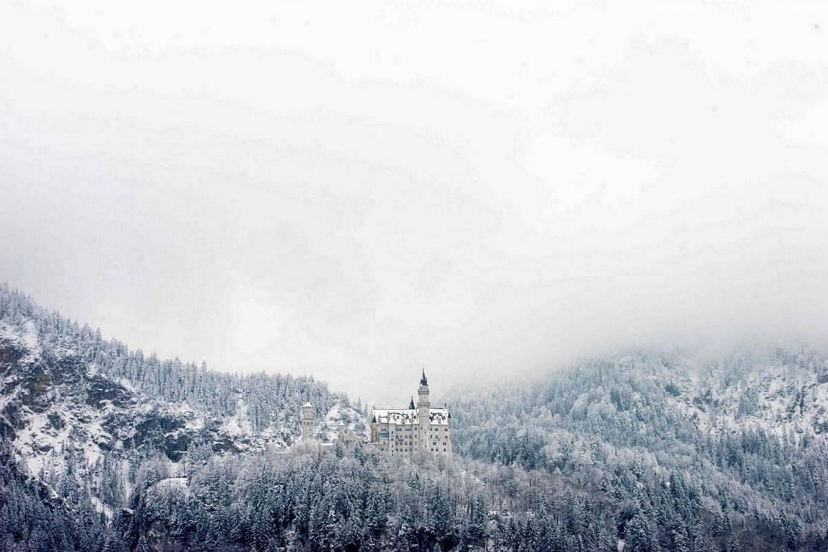 Snow-covered forests surround the Neuschwanstein Castle in Hohenschwangau, on Feb 22, 2018.