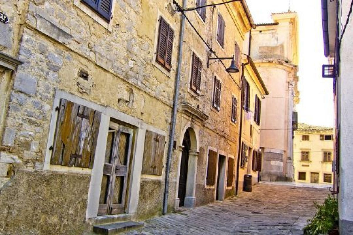 Tiny but charming Buzet (above) consists of mediaeval buildings in diverse stages of ageing and refurbishment.