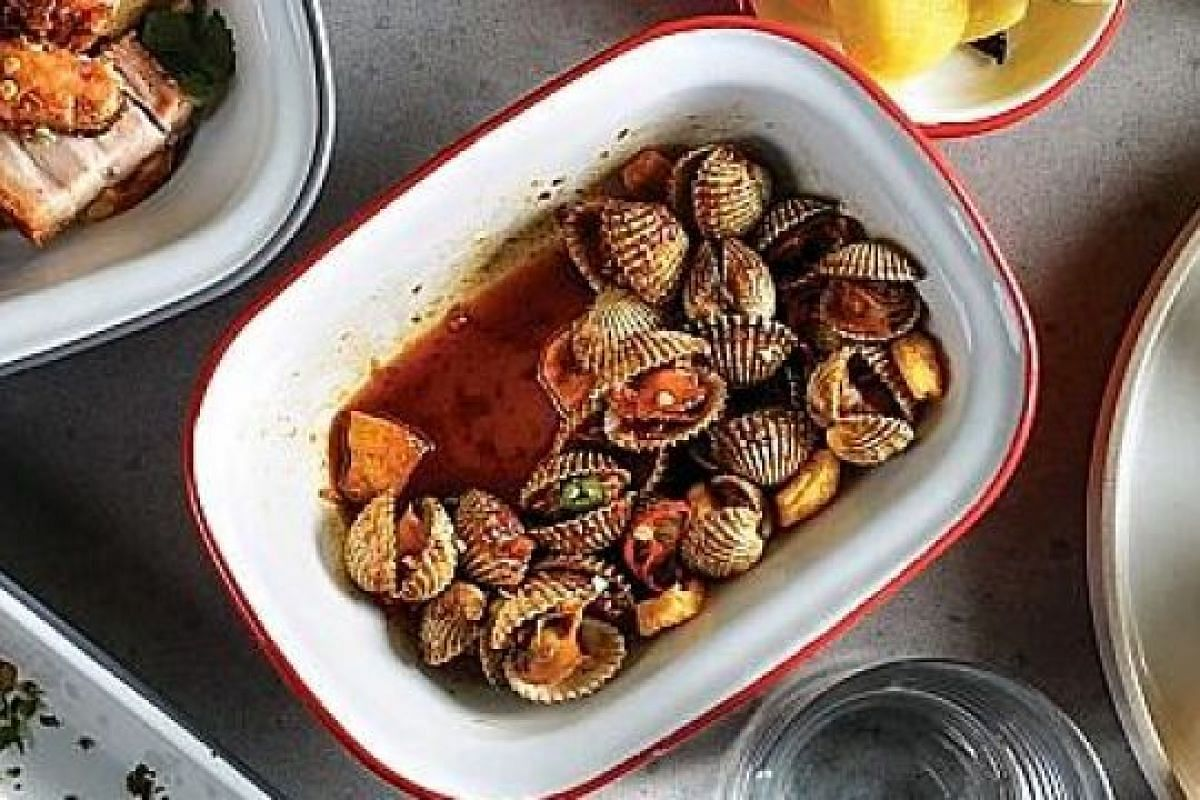 Blood Cockles (above) is an appetiser portion of cockles in half-shells sauteed in chilli jam and fish sauce caramel.