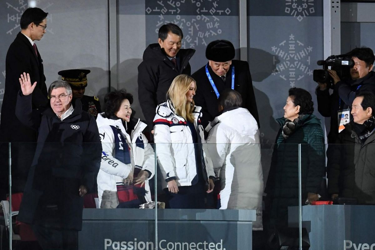 South Korea's President Moon Jae In shakes hands with North Korean General Kim Yong Chol (back), next to senior White House adviser Ivanka Trump and International Olympic Committee president Thomas Bach during the closing ceremony of the Pyeongchang