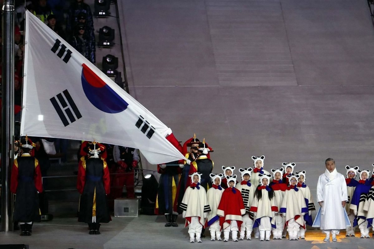 The South Korean flag is lowered as artists perform during the closing ceremony of the Pyeongchang 2018 Winter Olympic Games.