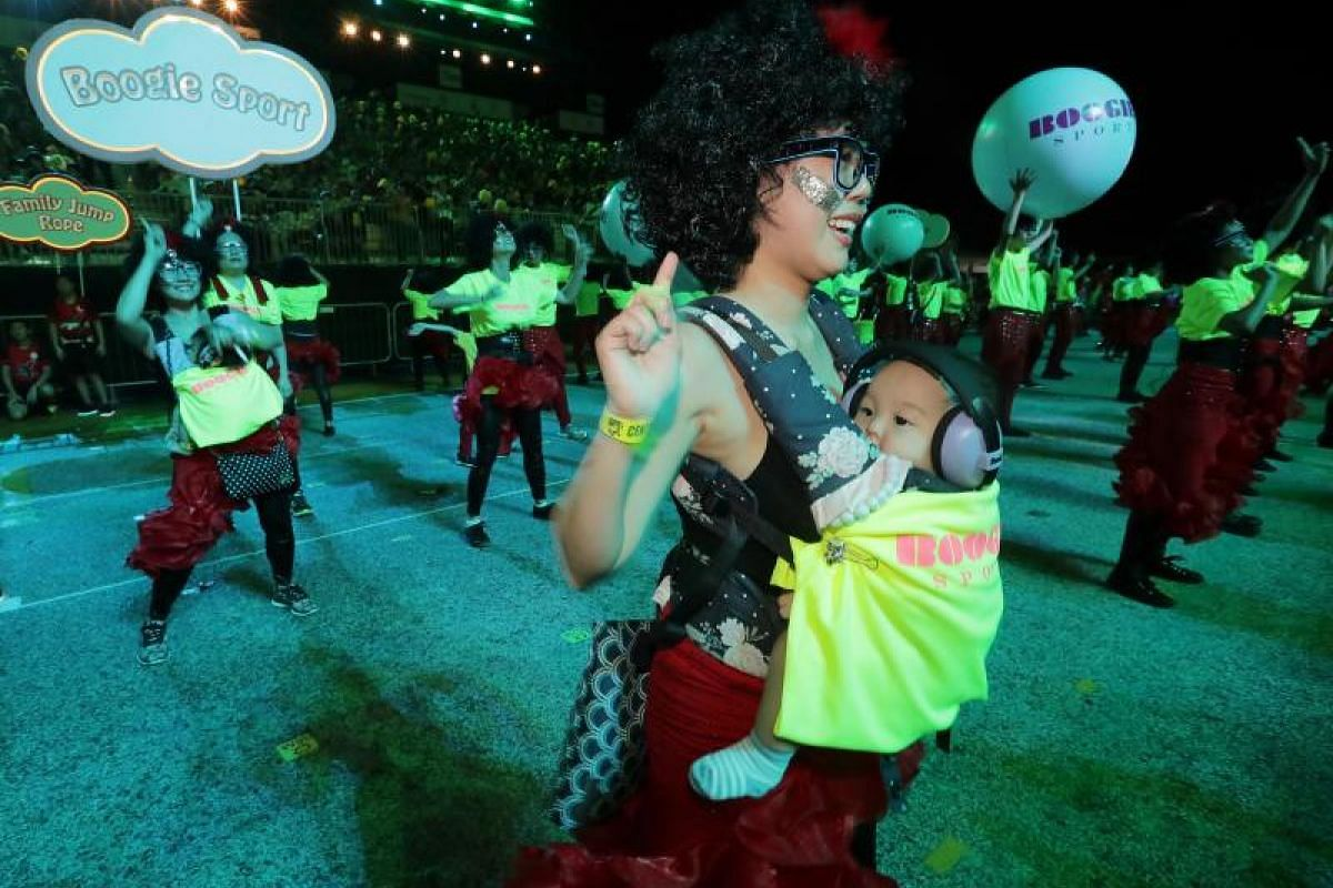 A performer with her baby during the Chingay parade.