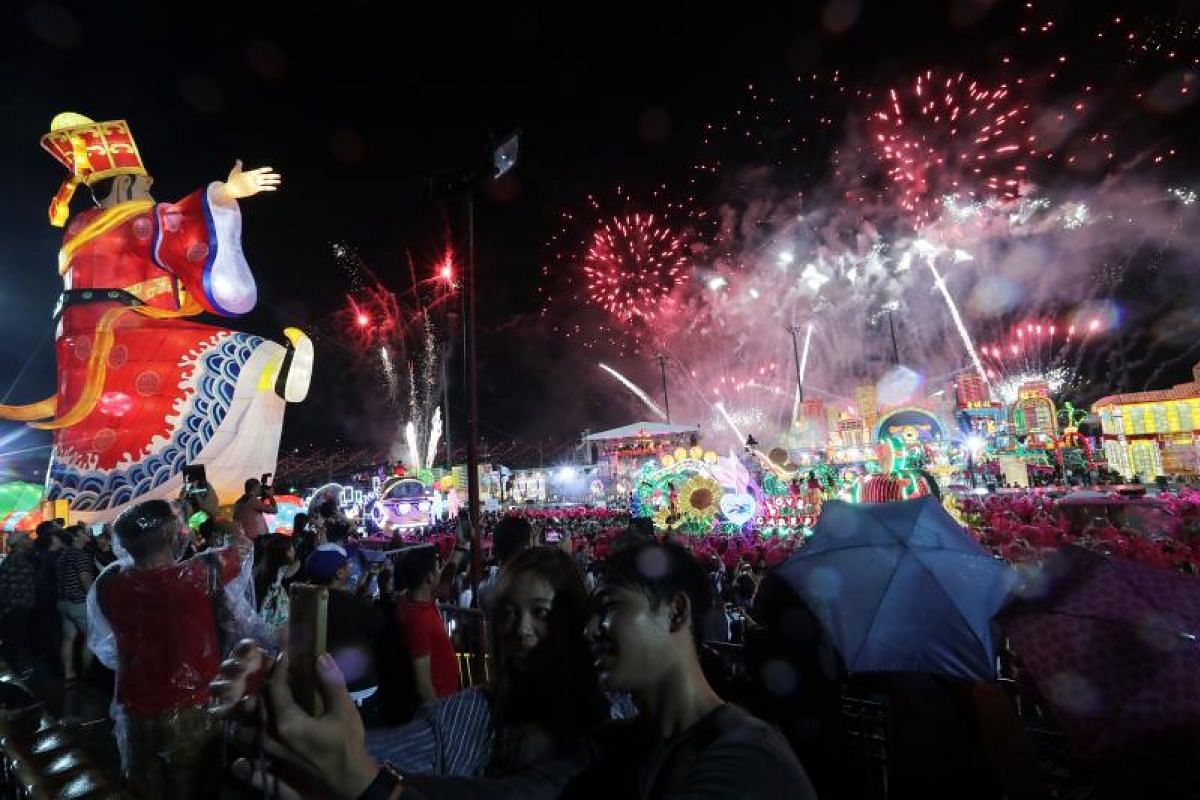 Members of the audience take a selfie at the Chingay parade.