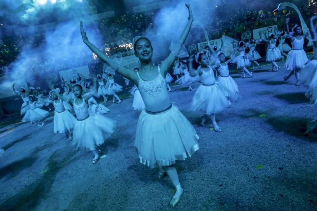 Ballerinas perform during the Chingay parade.