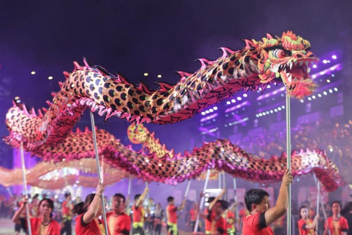 The F1 Pit Building at Marina Bay was awash in brilliant hues as dragon dancers shared the stage with stilt walkers and festive drummers in the annual Chingay celebrations.
