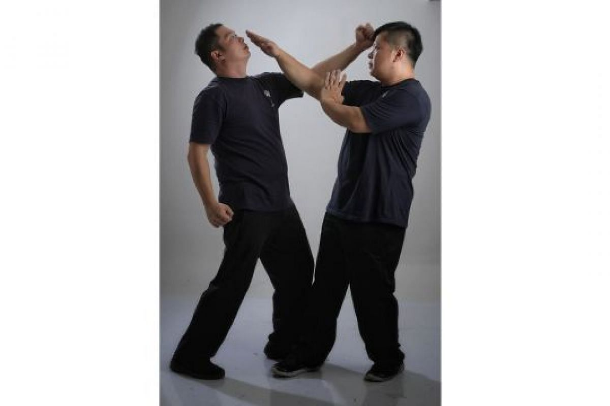 DARTING HAND (BIU SAU): A move that is both a block and a strike. It can deflect straight punches to the head (left), as well as strike the attacker's eyes, neck or throat.