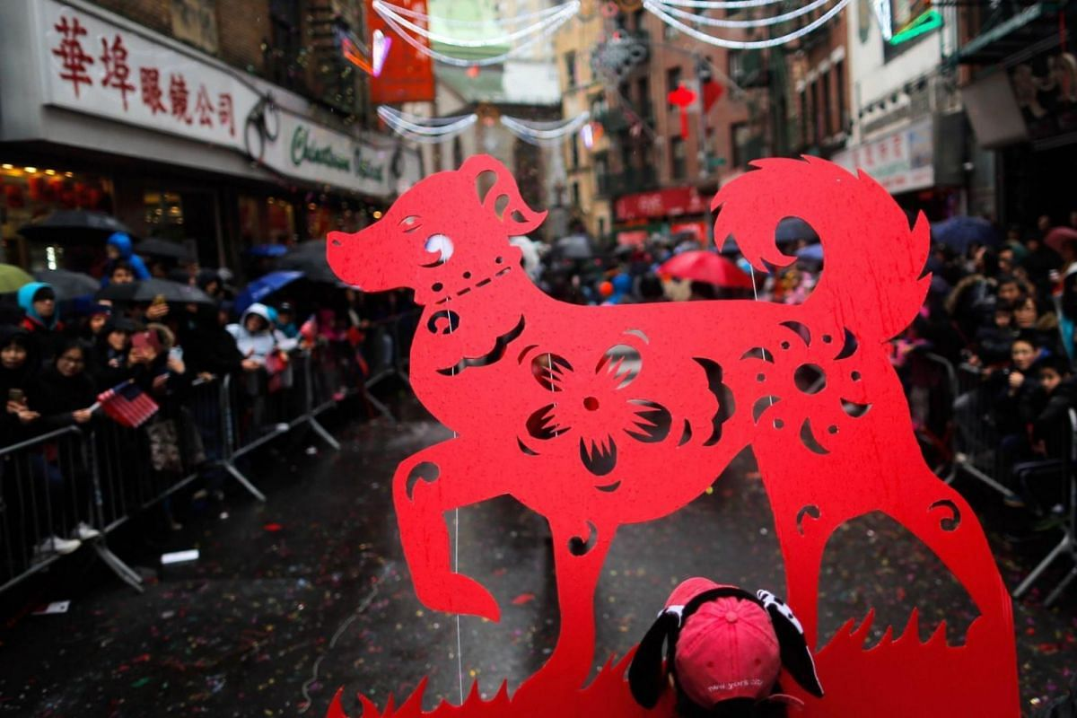People taking part in a Chinese New Year parade in Chinatown on Feb 25, 2018 in New York City.